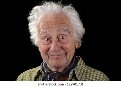 funny old man wearing a green checked shirt with white hair smiling