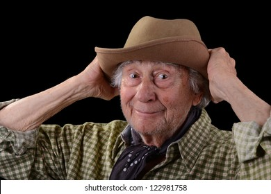 funny old man wearing a green checked shirt and a tan felt hat
