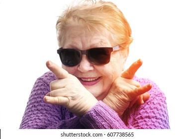 Funny old woman, grandmother having fun, wearing sunglasses, on white background, dance, rock