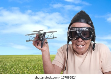 Funny old woman with a pilots hat and goggles