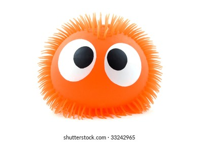 Funny orange face with big eyes in closeup over white background