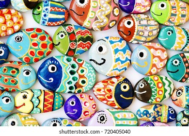 Funny painted acrylic pebbles background