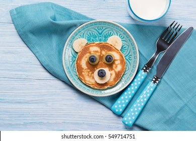 Funny pancake in a shape of teddy bear, food for kids idea, top view