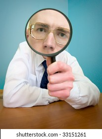 Funny people with a magnifier in a hand