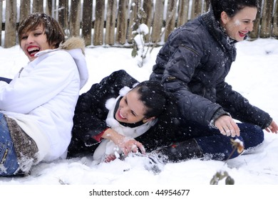 funny people playing in snow