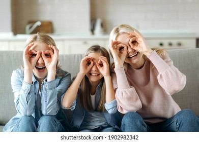 Funny photo of grandmother daughter and granddaughter. Cheerful caucasian grandmother daughter and granddaughter are having fun at home, indulge, and enjoy joint leisure