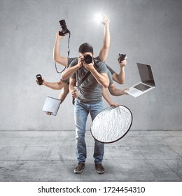 Funny photographer with a lot of equipment