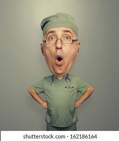 funny picture of bighead amazed doctor in glasses over dark background