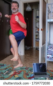 funny picture of a man doing sports on self-isolation