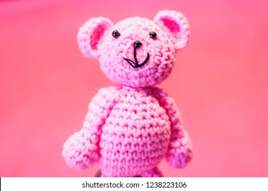 Funny pink manufactured teddy bear, a concept image for a newborn baby girl, expecting a baby illustrative image.