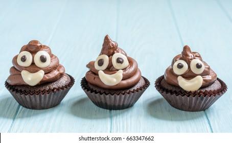 Funny poop emoji chocolate cupcakes. Cute food dessert