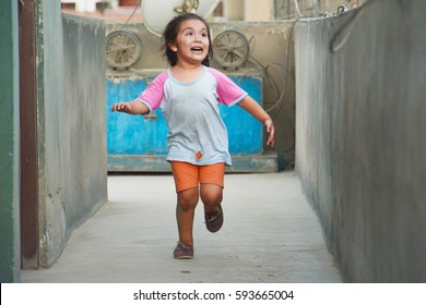 Funny poor latin kid running