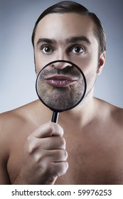 funny portrait of a adult man with a magnifying glass.