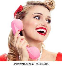 Funny portrait of beautiful woman with phone dressed in pin-up style, isolated over white background. Caucasian blond model posing in retro fashion and vintage concept studio shoot.