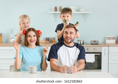Funny portrait of family in kitchen
