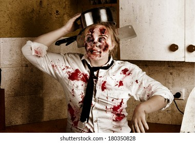 Funny portrait of a horror zombie cook doing evil halloween dance inside home with cuts wounds and burns from scalding saucepan