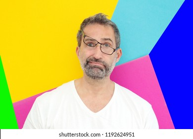 funny portrait of man with crooked glasses and colorful background