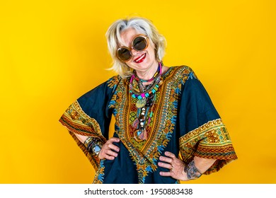Funny portrait of mature woman. Beautiful lady have fun dressed with seventies costume. Mature woman on colored backgrounds