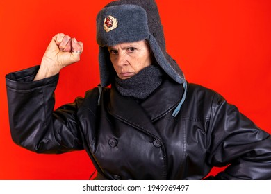 Funny portrait of mature woman. Lady posing dressed as a Russian soldier. Mature woman on colored backgrounds
