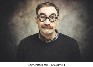 Funny portrait of a nerd man wearing nerd glasses