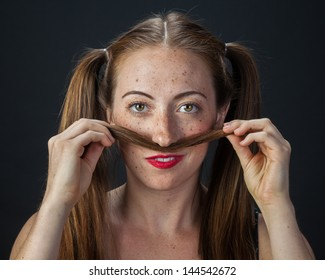 Funny portrait of a quirky girl playing with her pigtails.