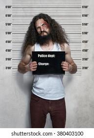 Funny portrait of a skinny hardened criminal