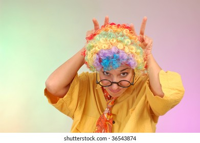 funny portrait of young woman wit wig make faces