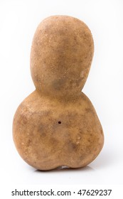 Funny potato shaped like a little mans head and body leaning forwards against white background.