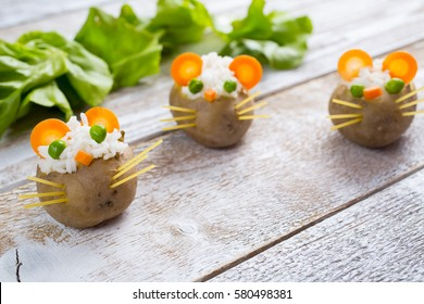 Funny potatoes stuffed with rice in the form of mouse
