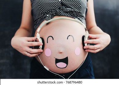 Funny pregnant belly. Pregnant woman