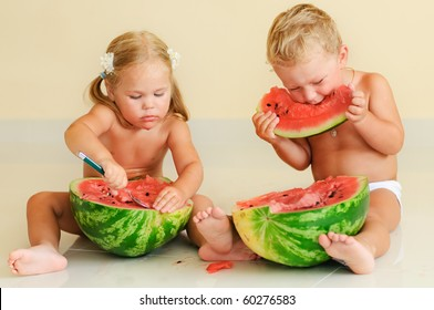 funny pretty kids eating with appetite ripe watermelon
