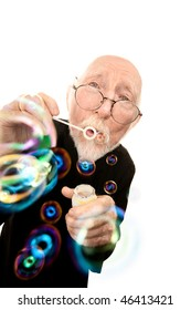 Funny Priest in Robe with Glasses Blowing Bubbles