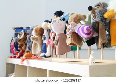 Funny puppets in a kindergarten classroom.