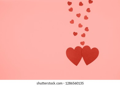 Funny red hearts fall in love. Romance and St Valentine day concept.  Horizontal. Living coral toning - color of the year