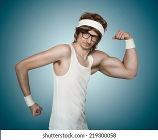 Funny retro nerd with one huge arm flexing his muscle over blue background