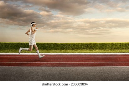 Funny, retro sports nerd jogging on the running track with copy space