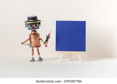 Funny robot artist poses with a pencil next to a wooden easel and a blank sheet of blue paper. Abstract advertising poster, presentation, invitation card template. Empty frame mockup. copy space.