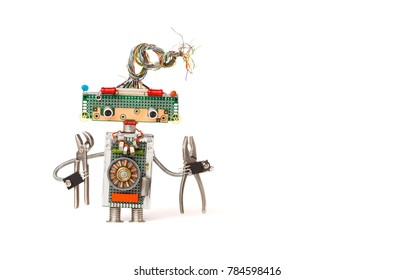 Funny robot electrician with pliers. Creative design robotic toy with electric wires hairstyle, electronic circuits, chip capacitors vintage resistors. White background copy text.