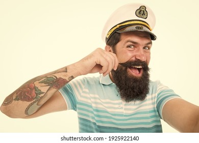 Funny sailor with cap and shirt. navy day. tourist on summer vacation. bearded man in captain cap has moustache. brutal man in sailor hat. summer marine male fashion. concept of tourism.