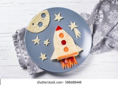 Funny sandwich with rocket and stars made of cheese, carrot and paprika, meal for kids idea