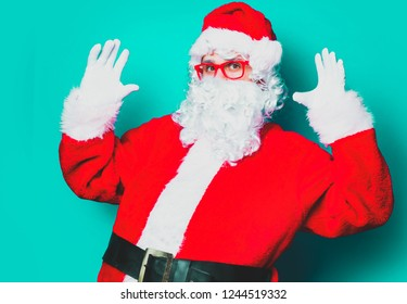 Funny Santa Claus have a fun with red eyeglasses on green background