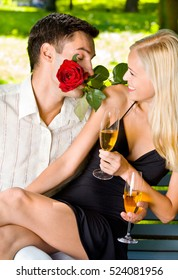 Funny scene of couple celebrating with champagne and rosa, outdoors. Love, flirt, romantic, relations, celebration theme concept.