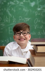 Funny schoolboy  holding book overhead, education concept