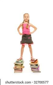 Funny schoolgirl standing on the books