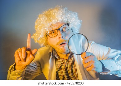 funny scientist, like Einstein with a magnifying glass