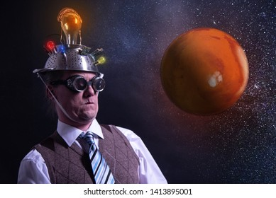 Funny scientist looking to universe and planet mars