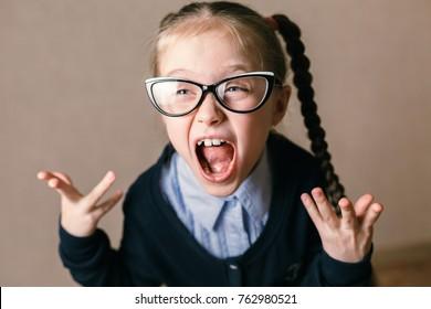 Funny screaming girl, studio shot. Educational concept