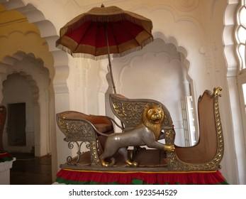Funny sedan chair with lion and umbrella in Meherangarh