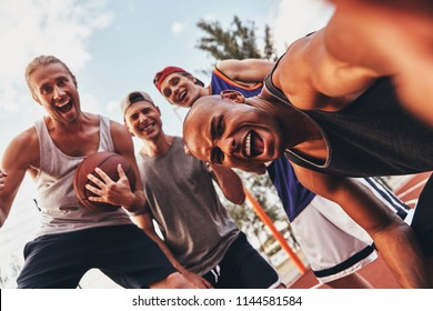 Funny selfie! Self portrait of young men in sports clothing smiling while standing outdoors