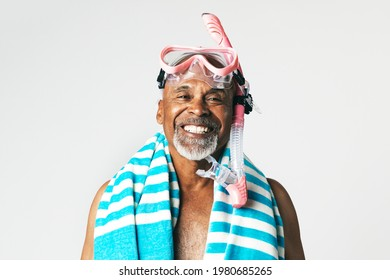 Funny senior African American man wearing a pink snorkel and goggles